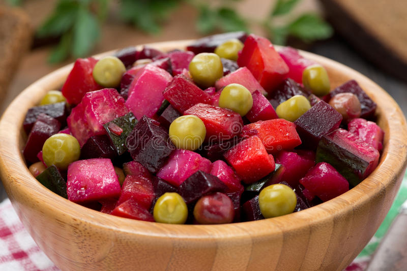 Russian beetroot salad vinaigrette in a wooden bowl, close-up stock photos