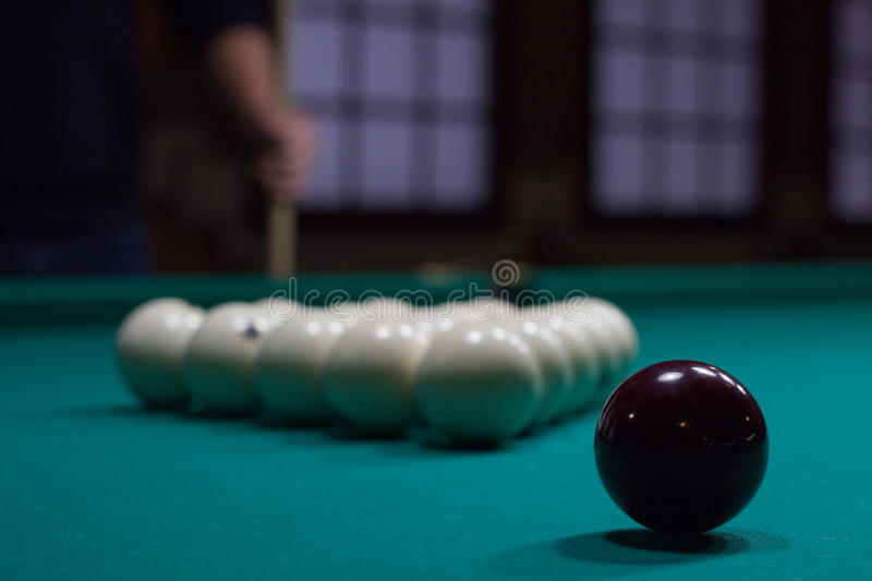 Russian billiards: black and white balls on green table royalty free stock photo