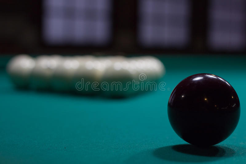Russian billiards: black and white balls on green table cloth stock images