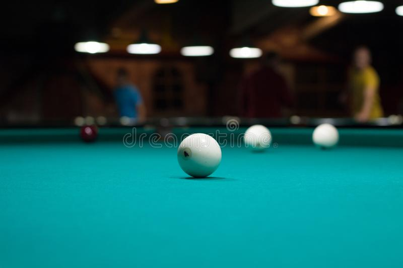 Russian billiards in club: balls on green game table royalty free stock photo