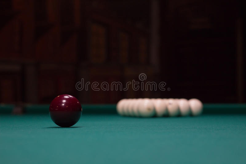 Russian billiards: red and white balls on green table cloth stock photo