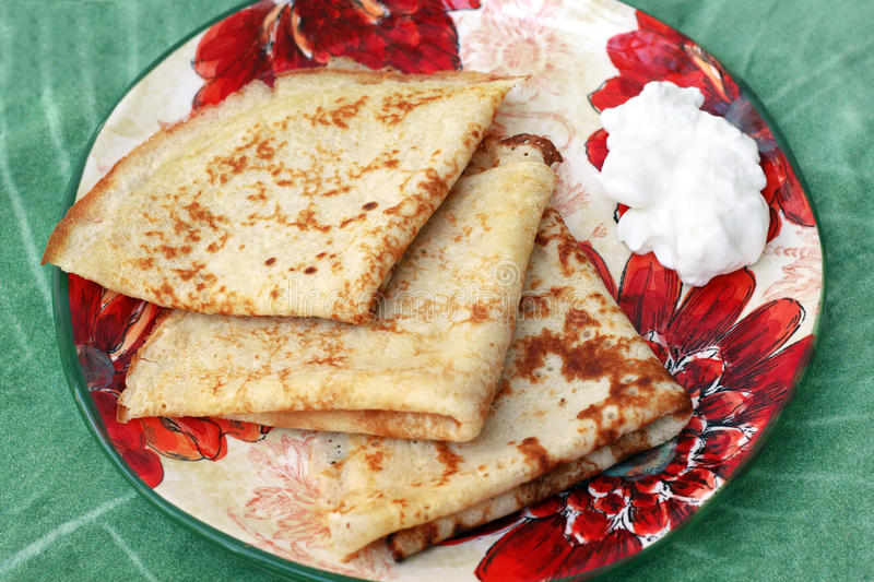 Russian blini. Russian pancakes or blini with sauer cream royalty free stock images