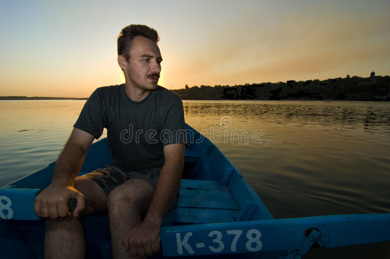 Russian boatman. At sunset on Don royalty free stock image