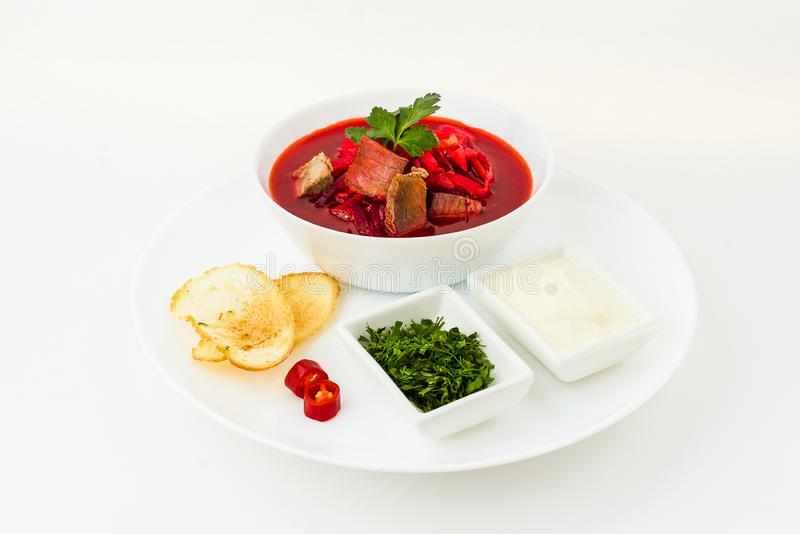 Russian borsch with cream in plate isolated on white stock photo