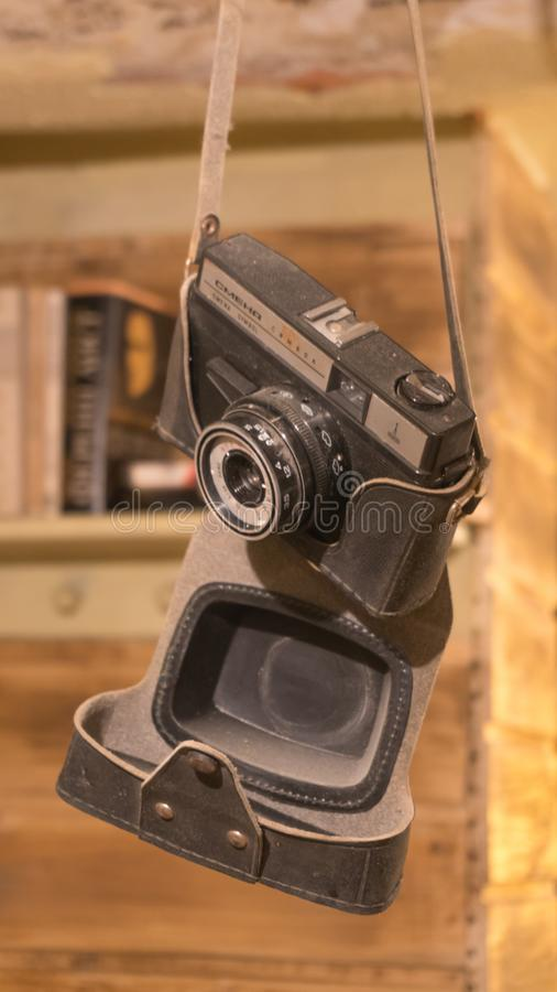 Russian camera Smena, hanging, 22.12.2018, Varna, Bulgaria. Vintage classic dusty hanging Russian camera Smena, used as vintage style decoration, 22.12.2018 stock photography