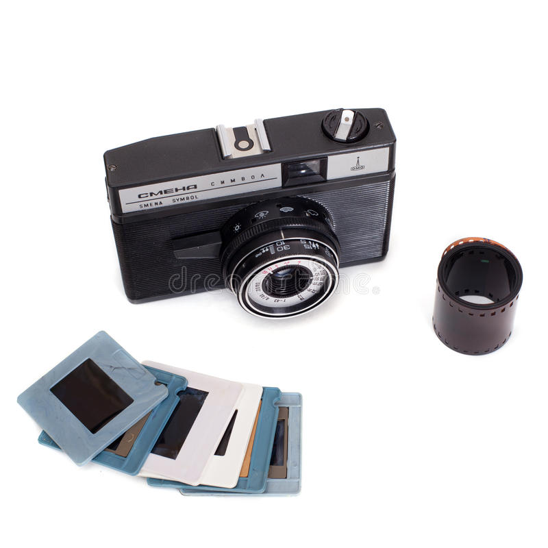 Russian camera Smena Symbol with spun film and diapositive slides royalty free stock photo