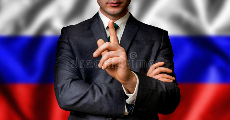 Russian candidate speaks to the people crowd. With one finger on lips - election in Russia stock image