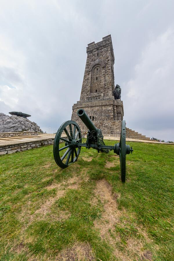 Russian cannon near the Bulgarian monument on Shipka royalty free stock image