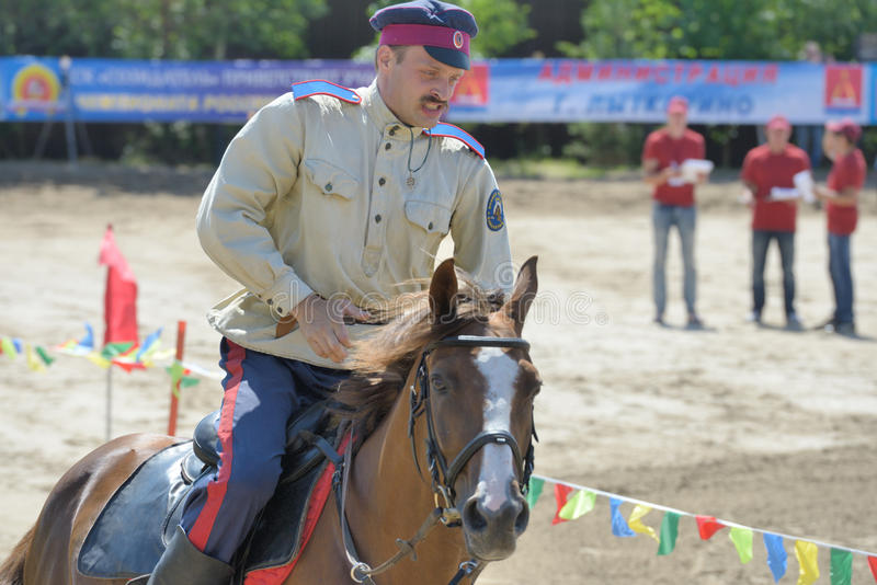 Russian championship in trick riding. Lytkarino, Moscow region, Russia - July 12, 2014: Anton Portnov from Moscow performs stunts during Russian championship in royalty free stock photo