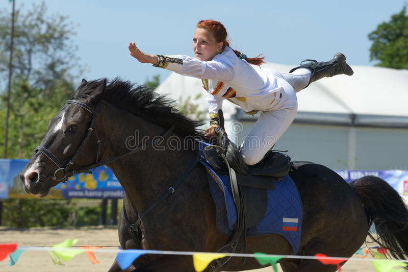 Russian championship in trick riding. Lytkarino, Moscow region, Russia - July 12, 2014: Maria Kholodova performs stunt during Russian championship in trick stock photos