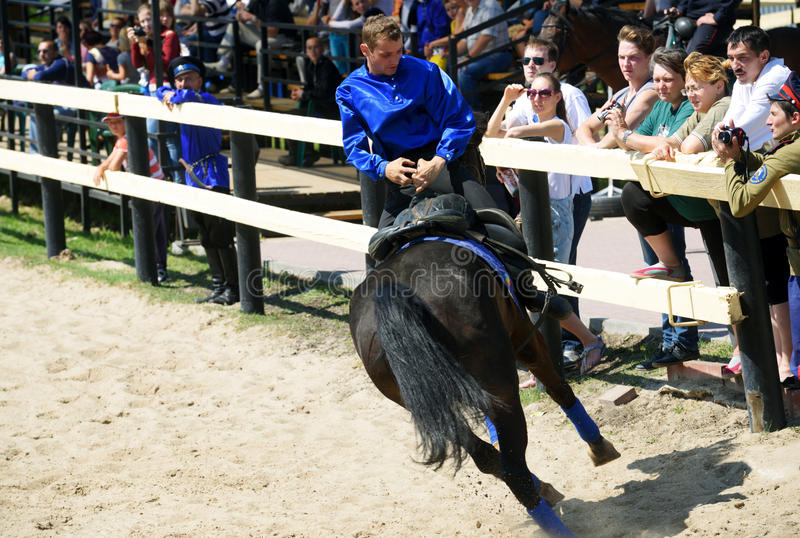 Russian championship in trick riding. Lytkarino, Moscow region, Russia - July 12, 2014: Rider performs stunts during Russian championship in trick riding stock image