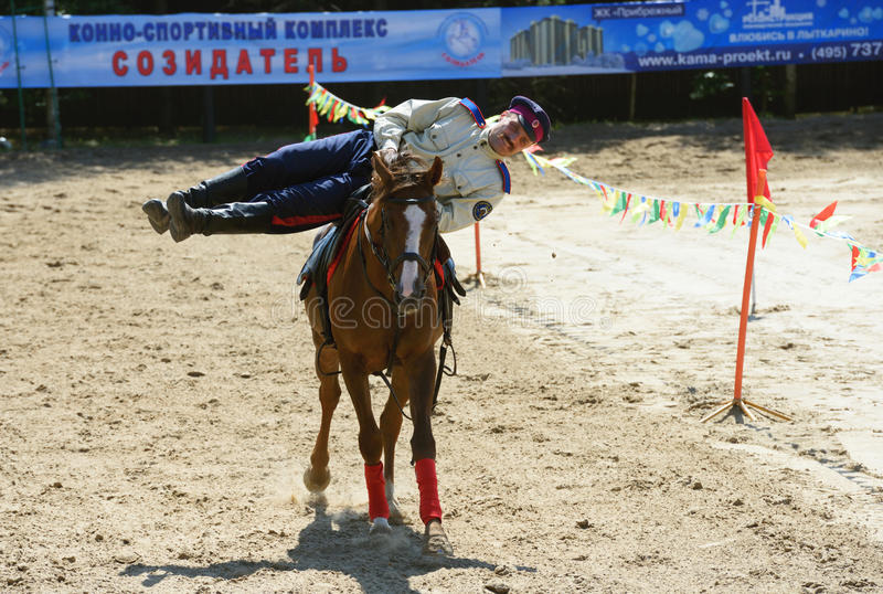 Russian championship in trick riding. Lytkarino, Moscow region, Russia - July 12, 2014: Rider performs stunts during Russian championship in trick riding stock images