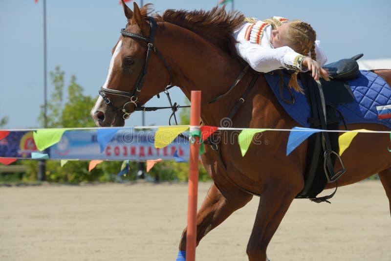 Russian championship in trick riding. Lytkarino, Moscow region, Russia - July 12, 2014: Svetlana Markina performs stunts during Russian championship in trick stock image