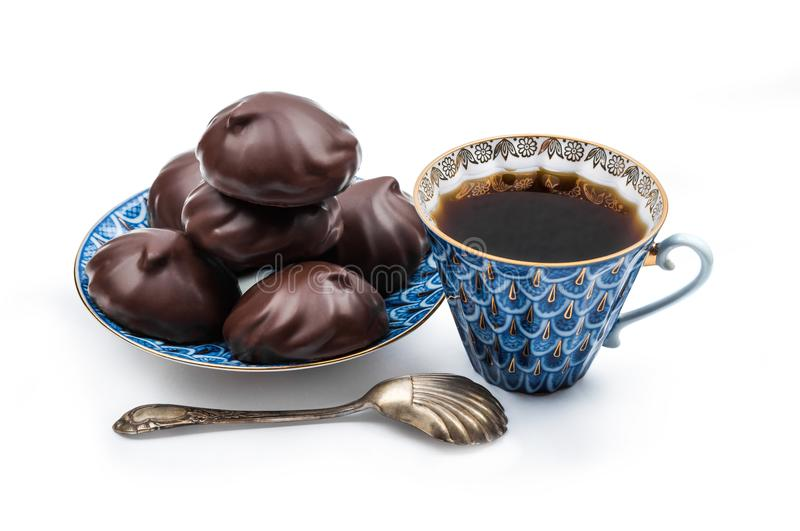 Russian chocolate-coated zefir on a blue saucer and black coffe royalty free stock photos