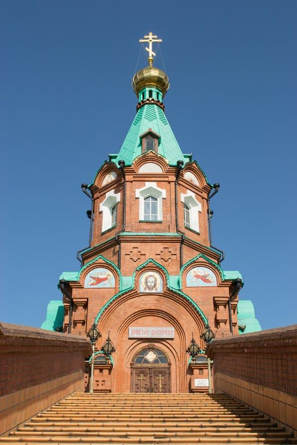 Russian christian church in krasnoyarsk. Steps to the temple Russian christian church in krasnoyarsk against the blue sky royalty free stock image