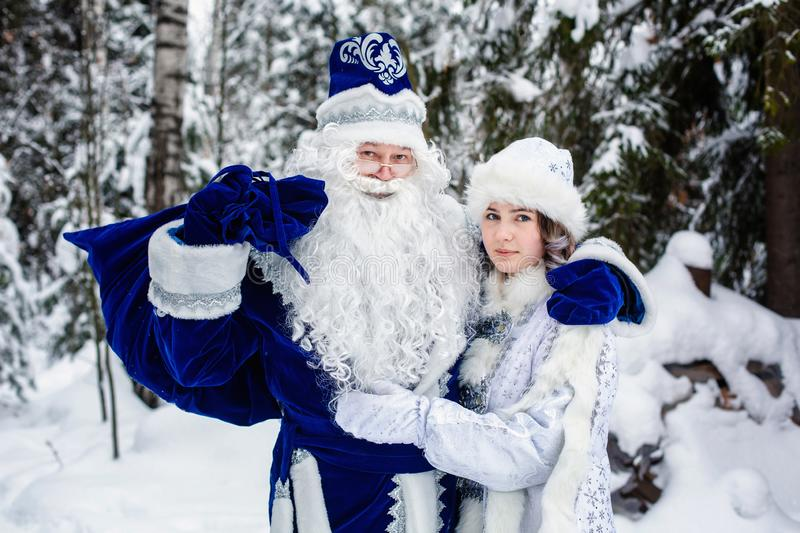 Russian Christmas characters Ded Moroz Father Frost  and Snegurochka snow maiden in a snowy forest stock photo