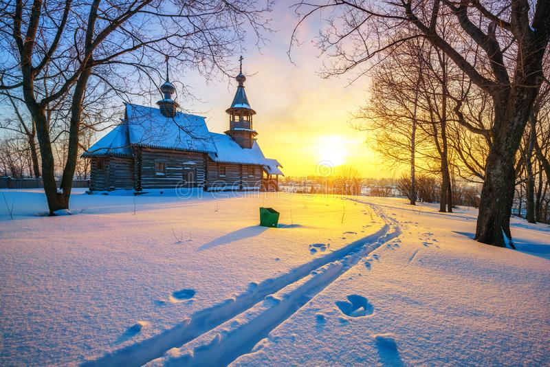 Russian church in winter forest royalty free stock image