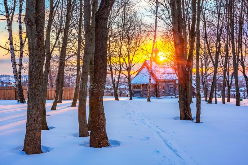 Russian church in winter forest royalty free stock photo