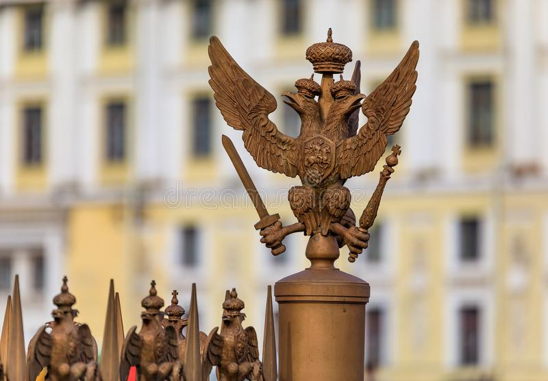 Russian coat of arms of imperial double headed eagle on the fence in Palace Square by Hermitage in Saint Petersburg, Russia stock photography