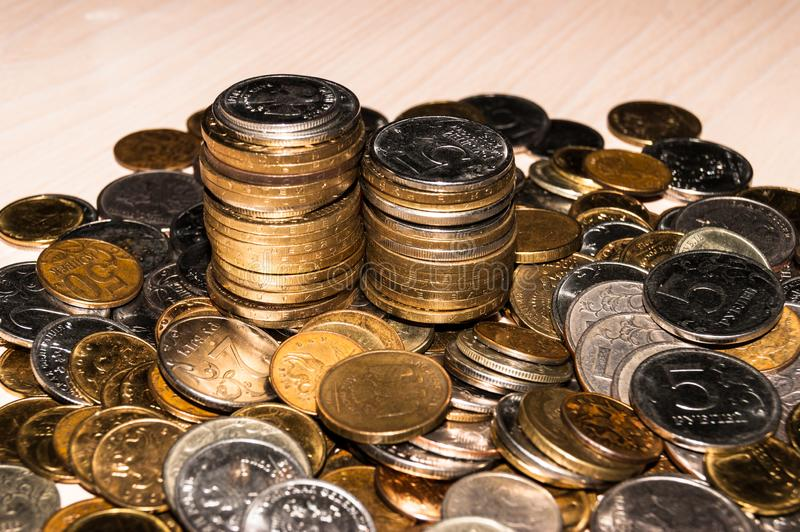 Russian coins of different denominations are in a heap on the table, piles of commemorative coins. Russian coins of different denominations are in a pile on the royalty free stock photo