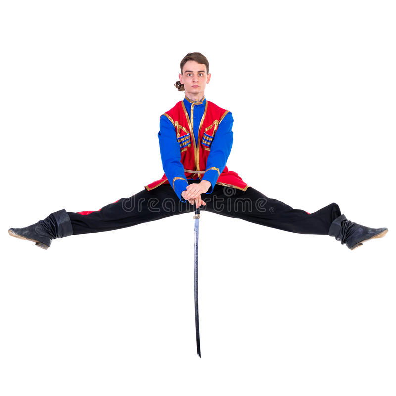 Russian cossack dance. Young dancer jumping over a. Russian cossack dance. Young dancer in ethnic clothes jumping over a sword. full length portrait isolated royalty free stock image