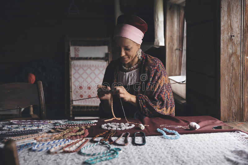 Russian craftswoman at work stock image