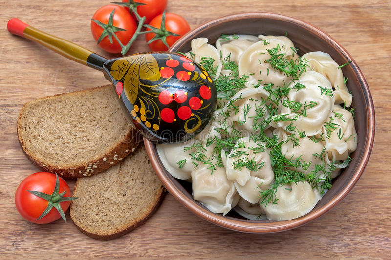 russian cuisine dumplings on a plate cherry tomatoes and bread stock image image of ceramic. Black Bedroom Furniture Sets. Home Design Ideas