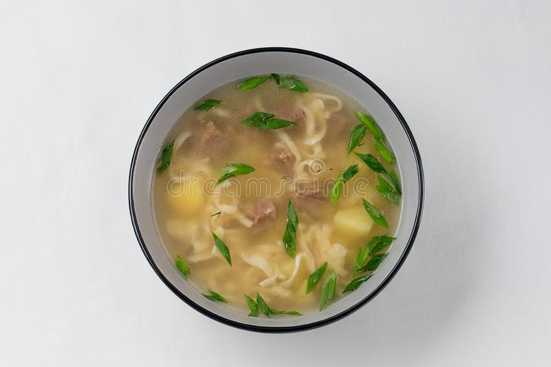 Russian cuisine. meat soup with homemade noodles stock images