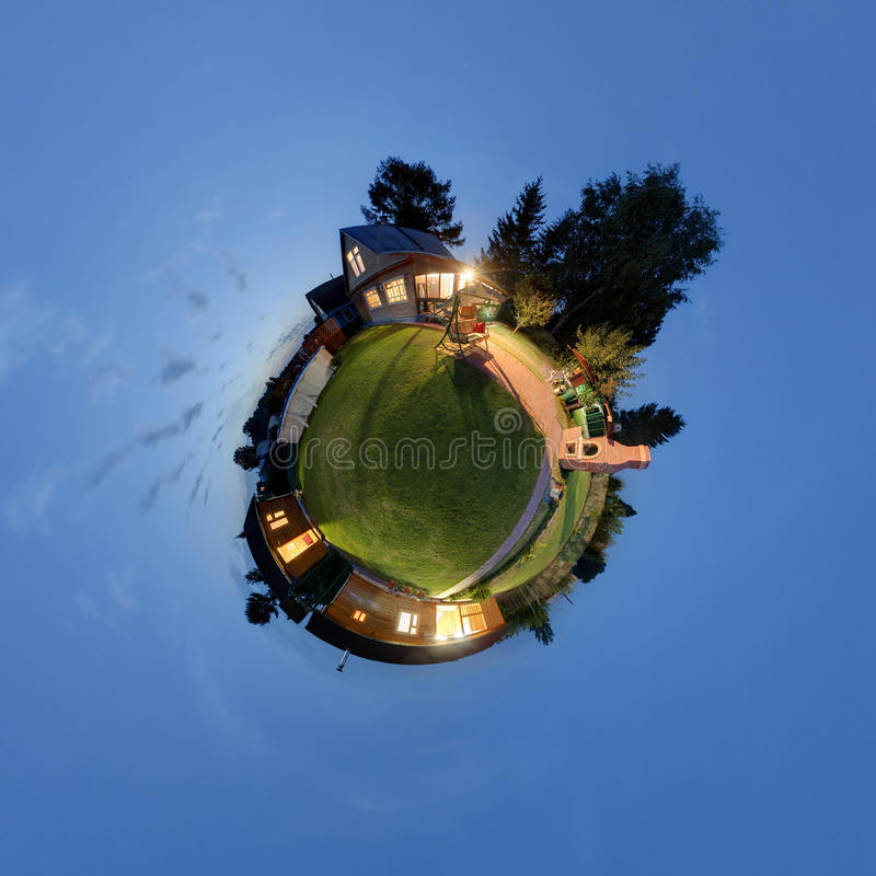Russian dacha where that in Siberia. 360-degree evening panorama of a russian dacha where that in Siberia. Little planet projektion royalty free stock photography