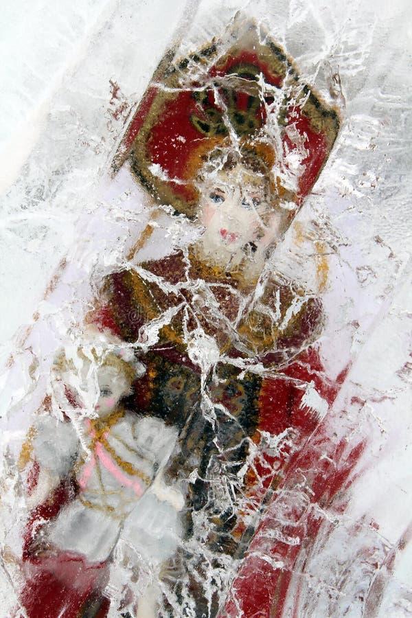 Russian doll in ice block stock photo