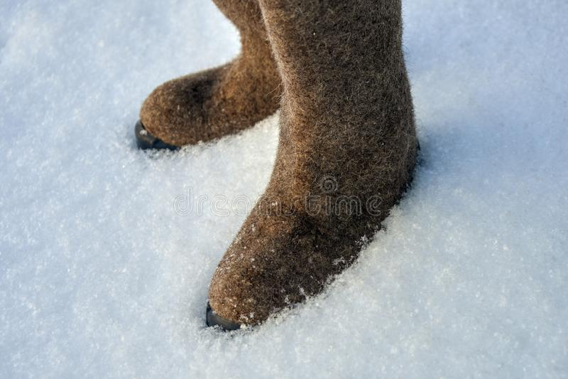 Russian felt winter shoes valenki on the white snow stock photos