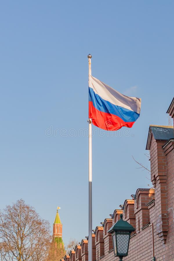 Russian flag on the background of the Kremlin.  stock photography