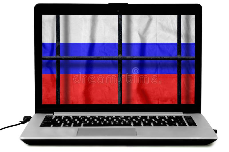 Russian flag behind black metal bars of a grate on the computer screen stock photo