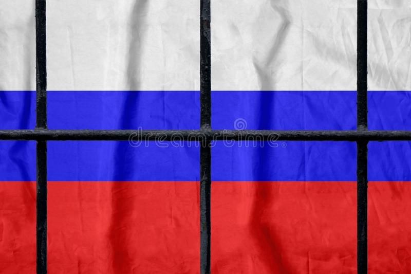 Russian flag behind black metal prison bars. Russian flag behind black metal bars of a prison grate without shadows. Symbol of oppression of freedom in Russia stock photography