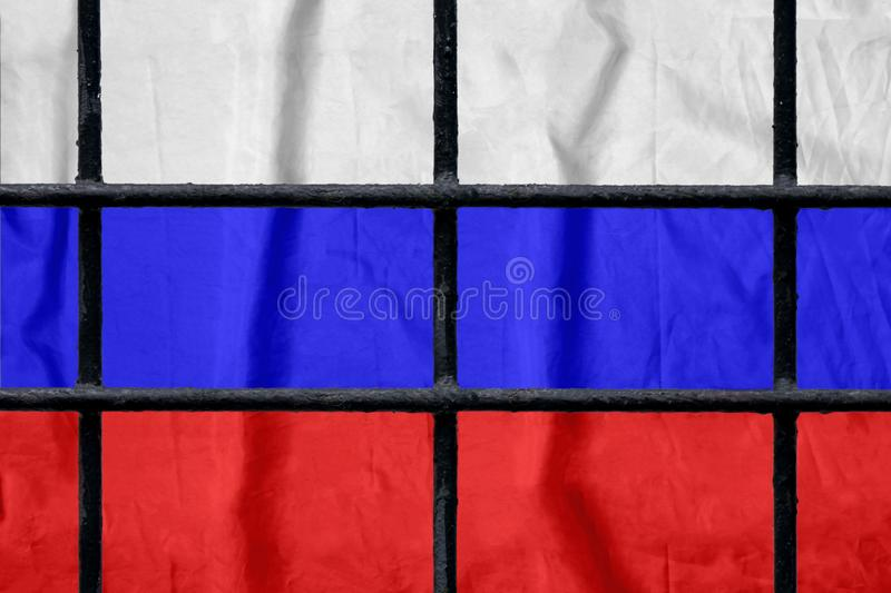 Russian flag behind black metal prison bars. Russian flag behind black metal bars of a prison grate without shadows. Symbol of oppression of freedom in Russia stock image
