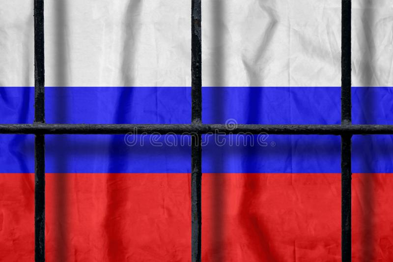 Russian flag behind black metal prison bars with shadows royalty free stock photo