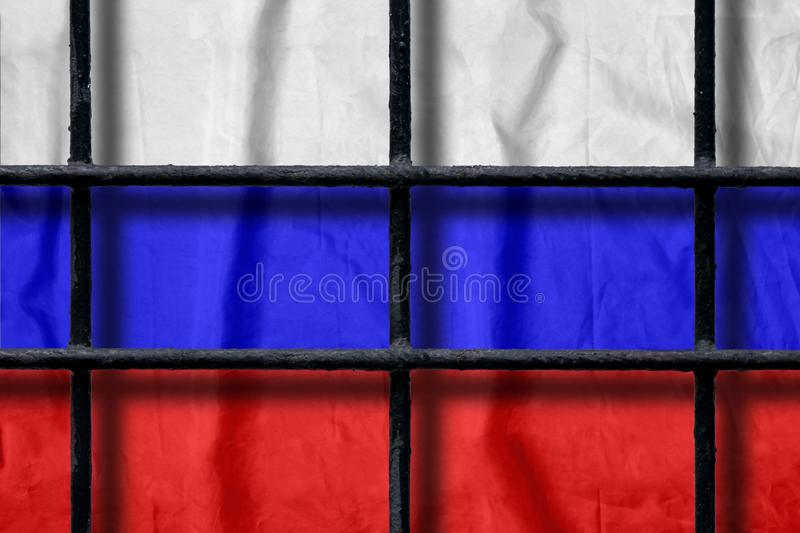 Russian flag behind black metal prison bars with shadows stock images