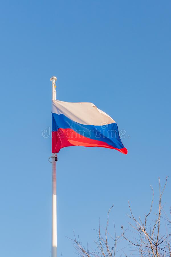 Russian flag on blue sky background.  stock images