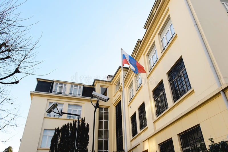 Russian Flag Embassy and surveillance camera. STRASBOURG, FRANCE - DEC 25,2015: Surveillance cameras next to Russian Federation flag waving in front of Embassy royalty free stock photo