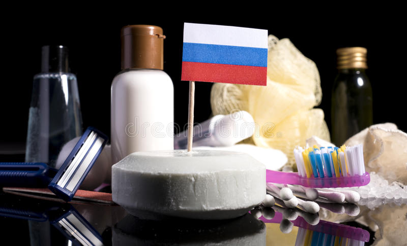 Russian flag in the soap with all the products for the people hygiene royalty free stock photos