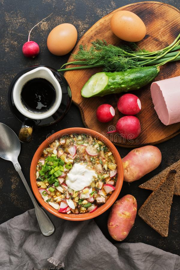 Russian food okroshka on a dark background, top view. Cold summer soup. Russian food okroshka on a dark background, top view. Cold summer soup royalty free stock images