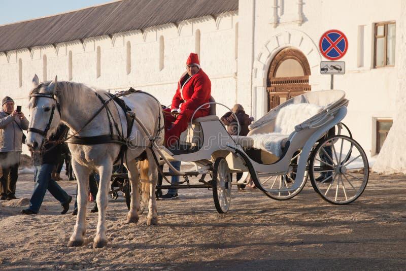 Russian fun. Riding a coach near the walls of the Kazan Kremlin. royalty free stock images
