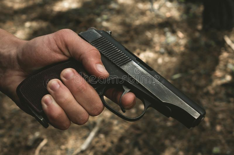 Russian gun black in the man& x27;s hand royalty free stock photo
