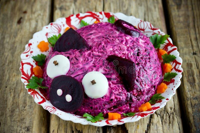 Russian herring under fur coat salad or dressed herring shaped funny pink pig stock image