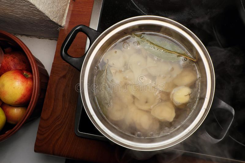 Russian homemade dumplings cooked in a pan stock photography
