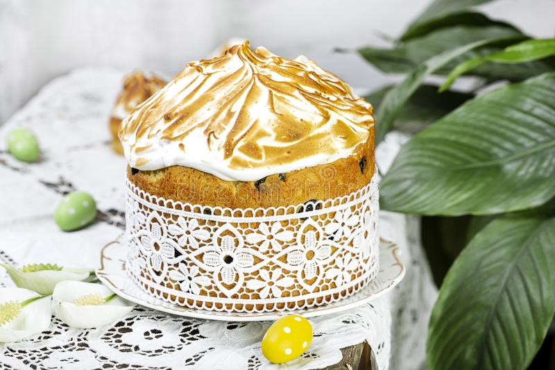 Russian homemade Easter cake with raisins, meringue. Russian homemade Easter cake with raisins and meringue royalty free stock photos