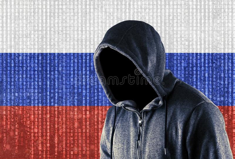 Russian hooded computer hacker stock photo