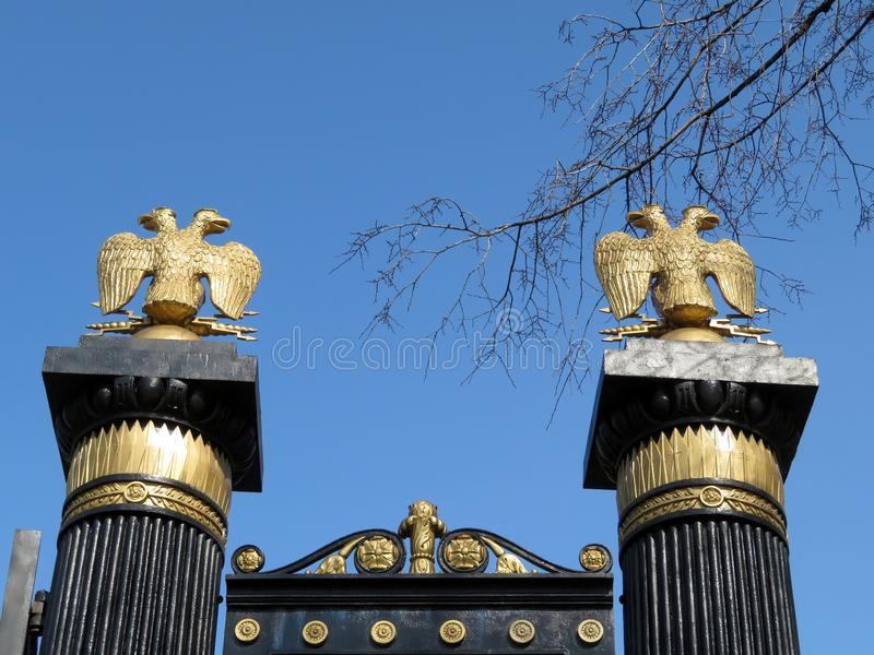 Russian imperial double headed eagles. Russian imperial eagles on the gates of the Alexander garden in Moscow. Symbol of Russian power royalty free stock images