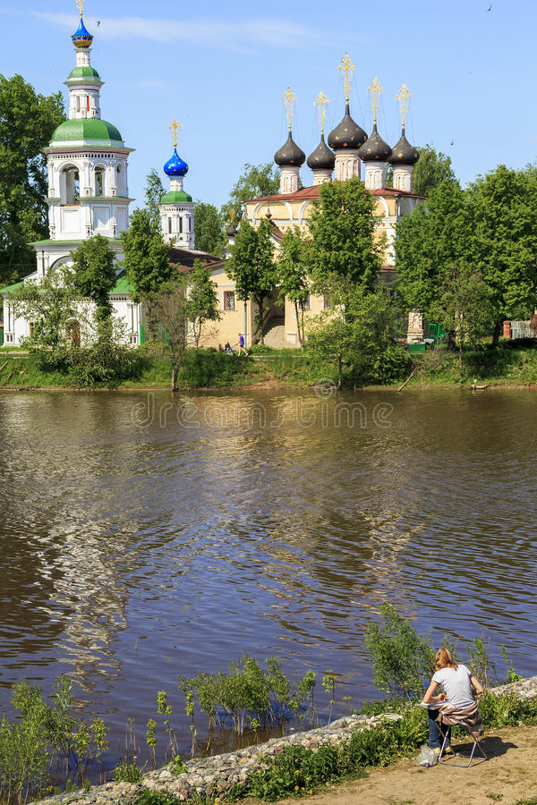 Russian landscape in clear day. An unknown young artist draws from nature cityscape on a fine day May 29, 2013 in Vologda, Russia stock photography
