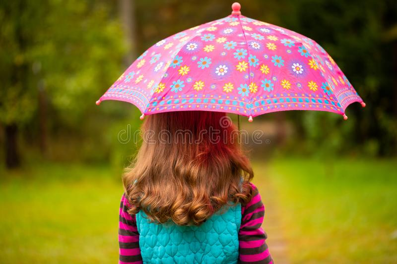Russian Little Girl With Brown Hair Under Umbrella In Autumn Par stock images